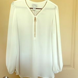 Bright white,long sleeve with large front zipper!